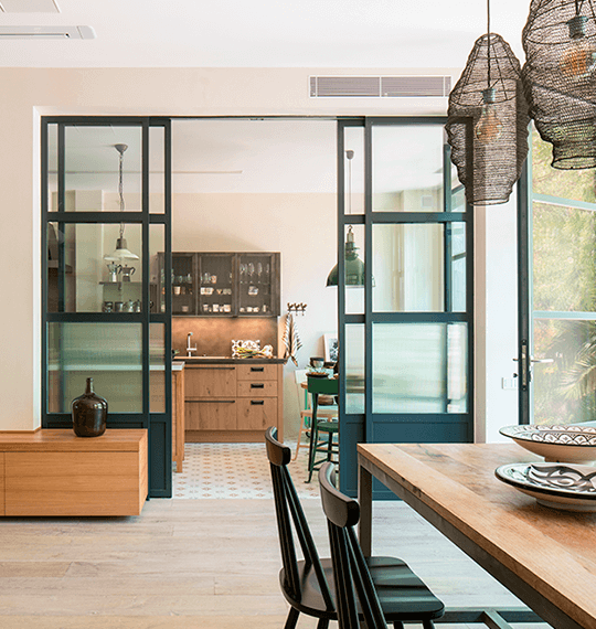 A kitchen with a view of the dining room | The Room Studio